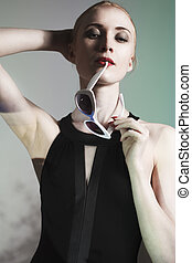 Fashion portrait of young elegant woman. Colored background, studio shot.