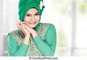 Fashion portrait of young happy beautiful muslim woman with...