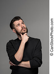 Fashion portrait of young man in black - Fashion portrait of...
