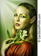 Fashion portrait of young sexy woman with creative green spring or summer make-up
