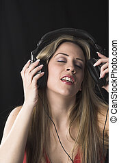 woman listening to music - fashion portrait of young woman...