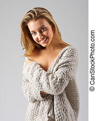 Fashion portrait of young woman on grey