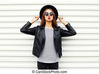 Fashion portrait pretty woman model in black rock style posing over white background