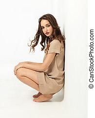 fashion portrait sexy young woman beige dress
