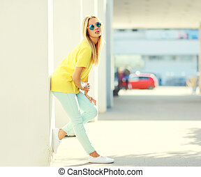 Fashion pretty blonde young woman in the city