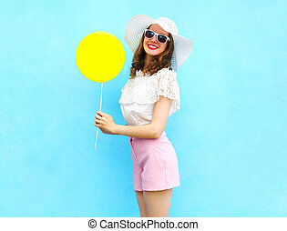 Fashion pretty smiling woman in straw hat with air balloon...