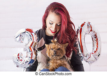 Fashion pretty woman celebrating her birthday with her puppy