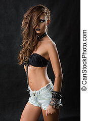 Fashion Rocker Style Model Girl Portrait. Hairstyle. Rocker or Punk Woman Makeup and Hairdo.