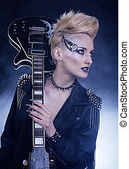Fashion Rocker Style Model Girl Portrait. Hairstyle. Punk Woman Makeup, Hairdo and black Nails. Smoky Eyes