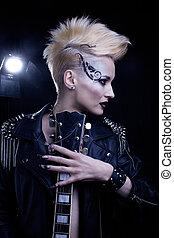 Fashion Rocker Style Model Girl Portrait. Hairstyle. Rocker or P