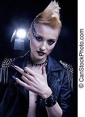 Fashion Rocker Style Model Girl Portrait. Hairstyle. Punk Woman Makeup, Hairdo and black Nails. Smoky Eyes hairstyle