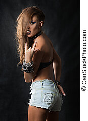 Fashion Rocker Style Model Girl Portrait. Hairstyle. Rocker or Punk Woman Makeup and Hairdo.