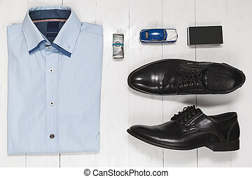 Fashion set of businessman accessories, top view on white wooden background