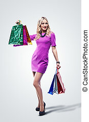 Fashion Sexy Girl full length Portrait. Woman with Shopping...