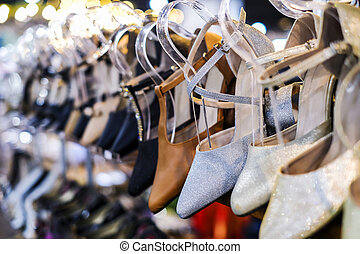 Fashion shoes on shelves in the shop