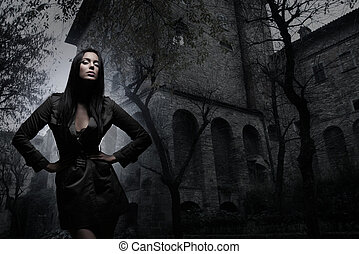 Fashion shoot of young and sexy brunette over the ancient...