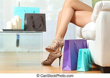 Fashion shopper legs with shopping bags