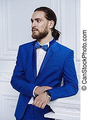 elegant blue suit - Fashion shot. Handsome young man posing...