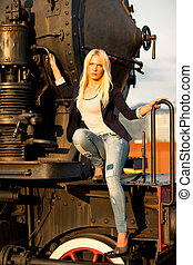 Fashion shot of a cute woman on railroad