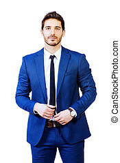 Fashion shot of a handsome man wearing elegant suit.