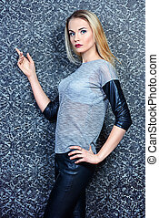 Fashion shot of an attractive young woman with blonde hair and evening make-up