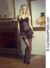 sexy blond girl in laced black lingerie , with stocking and high heel , in fashion old style ambient