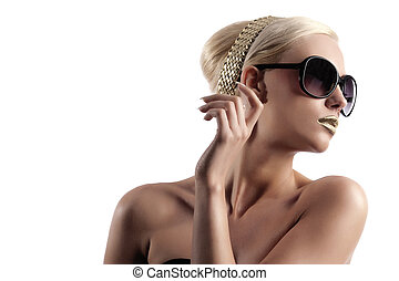fashion shot of blond woman with sunglasses on