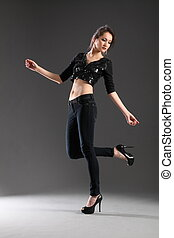 Fashion shot of girl in jeans - Flirty pose of fashion girl ...