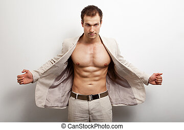 Fashion shot of sexy muscular man - Sexy handsome man with...