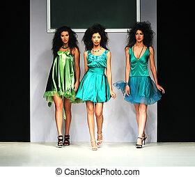 fashion show - young beautiful model walking on fashion show...