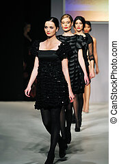 fashion show woman at piste walking in luxury dress