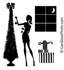 Fashion Silhouette of a Young Woman Decorating a Christmas Tree