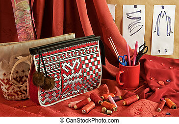 fashion sketches, handbags, red fabric, buttons and thread