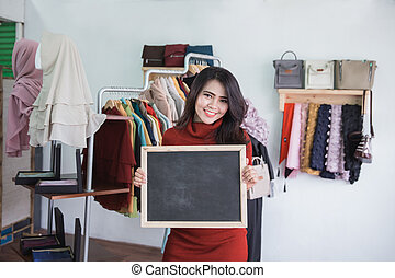 fashion store owner with blank board