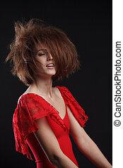 fashion studio portrait of beautiful young woman with long dark hair.
