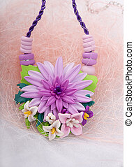 Fashion studio shot of a floral necklace (jewelery made of polym