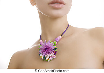 Fashion studio shot of beautiful woman with a floral handmade ne