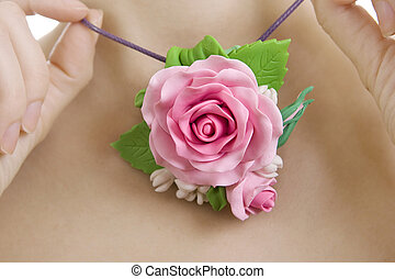 Fashion studio shot of woman with a floral necklace around her n