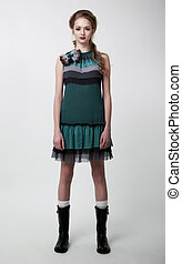 Fashion style - beautiful young girl posing in studio