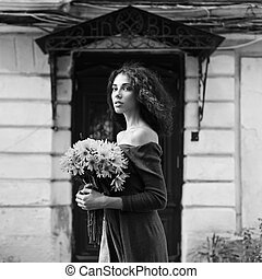 Fashion style colorless photo of a young woman