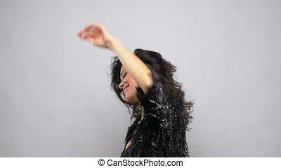 happy smiling beautiful young woman dancing