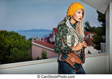 Fashion style photo of a young lady on summer evening