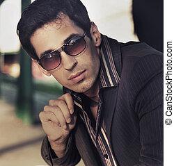 Fashion style photo of an handsome elegant man