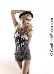 Fashion style photo of cute blonde woman