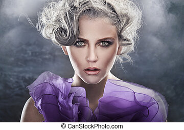 Fashion style portrait of a young lady over fantasy background
