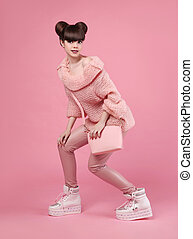 Fashion style teen look. Fashionable young girl wears in...