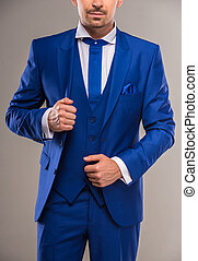 Fashion suit - Handsome nifty man in stylish blue suit and...