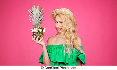 Fashion summer portrait of young pretty woman holding two...
