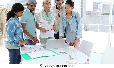 Fashion team brainstorming together