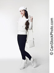 Fashion teen white style look. Fashionable young girl wears...